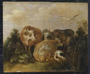 Koeien en ooievaars in een landschap