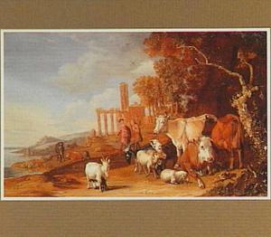 Vee in een landschap; op de achtergrond een ruïne
