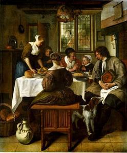 Een familie aan tafel in een interieur