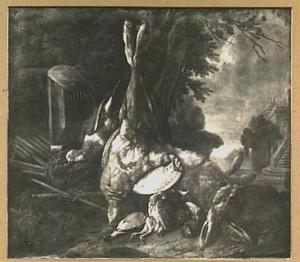 Jachtbuit van haas, patrijs en ander gevogelte in een park bij een paleis
