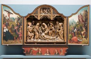 De kruisiging (binnenzijde linkerluik); De bewening (middendeel); De opstanding (binnenzijde rechterluik)