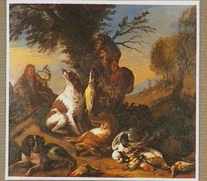 Rustende jager met jachthoorn bij jachtbuit in een landschap