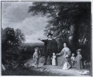Portret van een onbekende familie in een boslandschap