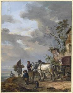 Driespan paarden etend uit een voederbak