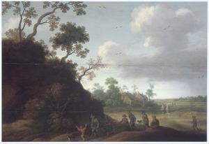 Landschap met kreupelen en andere figuren op een pad langs een heuvel