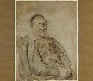 Portret van een zittende man met snor en sik