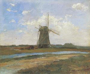 Windmill in sunlight near a stream