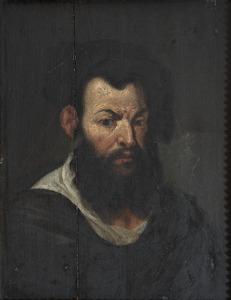 Man met een zwarte baard en zwarte baret