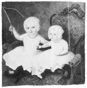 Twee kinderen in een fauteuil