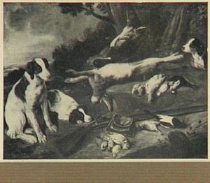 Honden bij jachtbuit van haas en gevogelte in een landschap