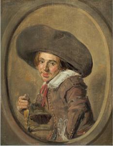 Portret van een zittende jonge man met een breedgerande hoed