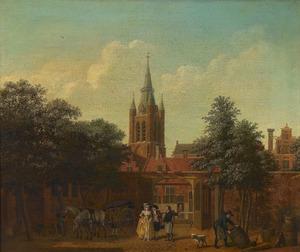 Binnenplaats van een herberg met in de achtergrond de toren van de Oude Kerk van Delft