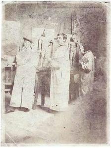 Johan H.A.G. Schmitt (links met hoed) tijdens de les aan de Quellinusschool te Amsterdam