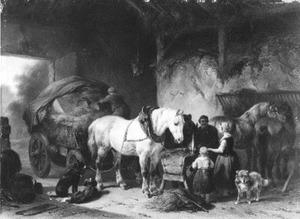 Paarden in een stal met een hooiwagen
