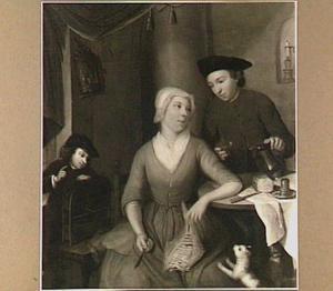 Man, vrouw en kind in een interieur bij een eettafel