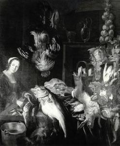 Keukenstilleven met jonge vrouw die vis schoonmaakt
