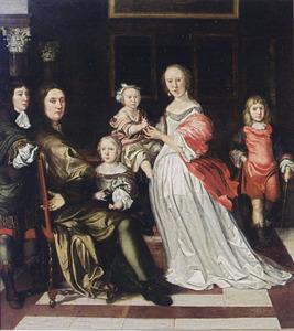 Ouders met vier kinderen in een interieur