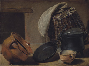 Een mand, kookgerei en een vuurtest op een keukenvloer