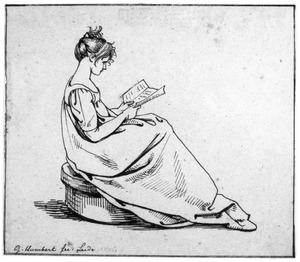 Zittend lezend meisje