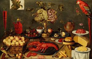 Stilleven van vruchten, glaswerk, kreeft, brood, kaas en twee papegaaien