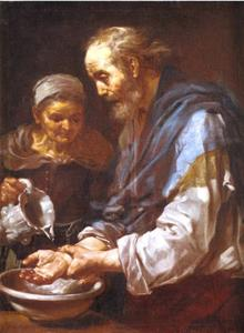 Een oude man die zijn handen wast