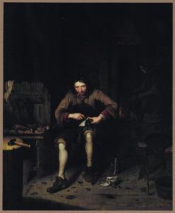 Een schoenmaker aan het werk