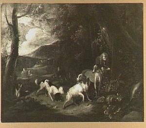 Jager met honden aan een bosrand