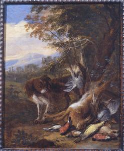 Een hond bij jachtbuit in een landschap, een jager in de achtergrond
