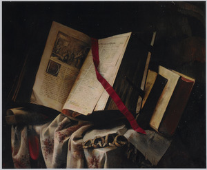 Boeken op een deels met een kleed bedekte tafel