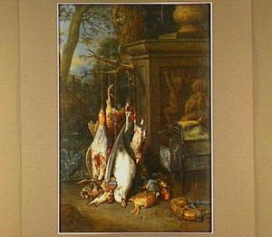 Jachtstilleven bij een postament met reliëf in een landschap