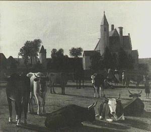Rustend vee op een weide buiten een dorp