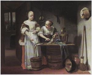 Twee jonge vrouwen in een keuken