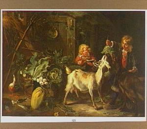 Twee kinderen met geiten bij een uitstalling van groente