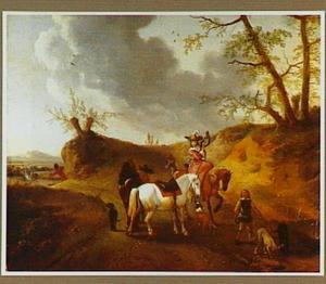 Heuvellandschap met jagers op een weg