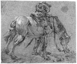 Grazend paard met ruiter