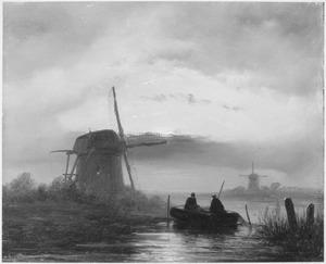 Vissers op een poldervaart bij avond