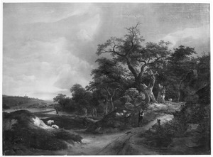 Boomrijk landschap met een schaapsherder op een zandweg