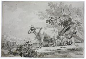 Het melken van een koe in een landschap