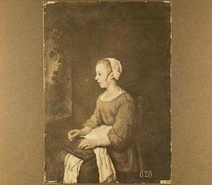 Jonge vrouw met verstelwerk bij een venster
