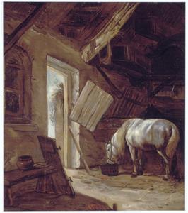 Een paard in een stal