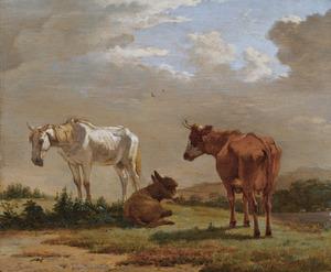 Een paard, een ezel en een koe in een landschap
