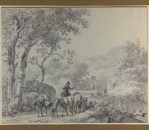 Heuvellandschap met herder en vee op een landweg