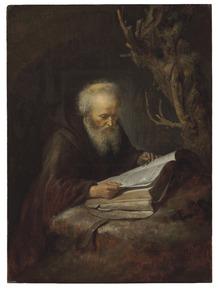 Kluizenaar de bijbel lezend in een grot