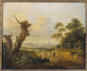 Duinlandschap met wandelaars op een pad langs een groep bomen