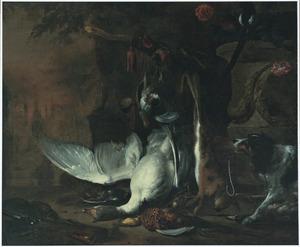 Jachtbuit bewaakt door een hond in een park