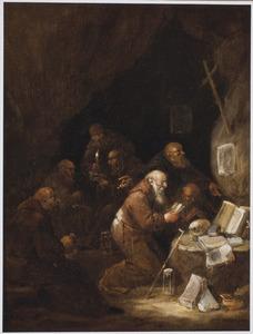 Biddende heremieten in een grot