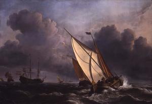 Een kaag op zee met andere schepen in een frisse wind