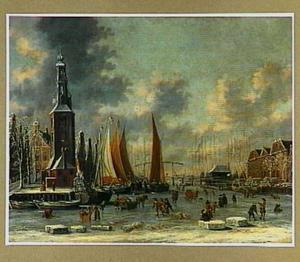 Wintergezicht in Amsterdam met de Montelbaenstoren, gezien vanaf de Scheepjesbrug over de Oude Schans