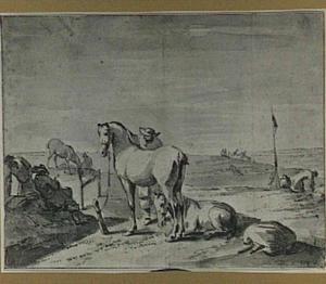Rustende ruiters in een heuvellandschap