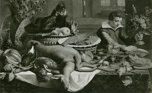 Een jongeman met een tazza bij een tafel met jachtbuit, allerhande voedsel en enig siervaatwerk